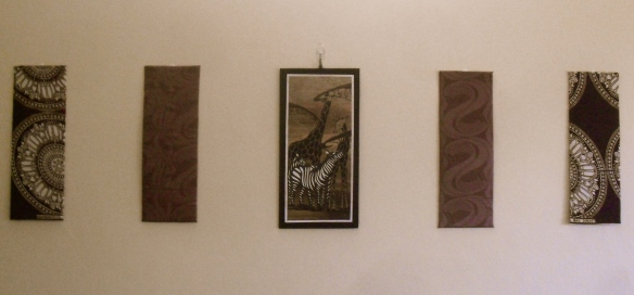 Close up of my wall art (the four on the sides are made from cardboard and scrap fabric)