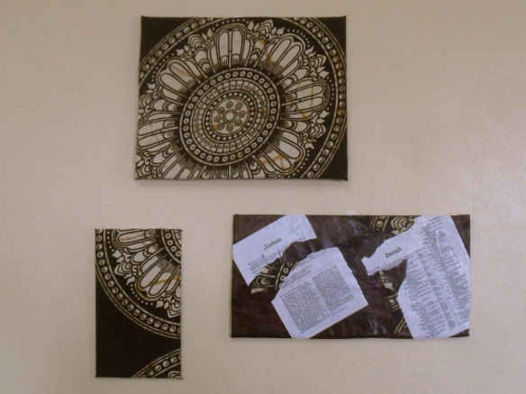 Wall art (made from cardboard, scrap fabric, and pages from an old, torn-up Bible)