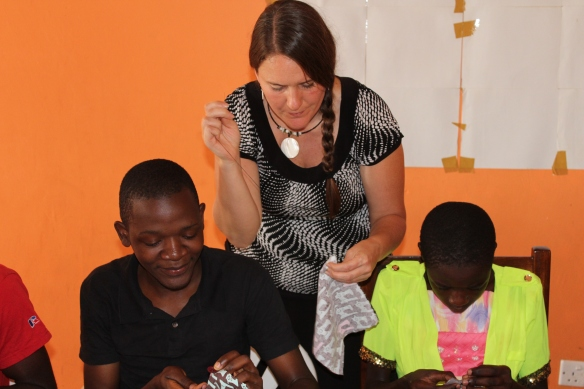 How do you know Linda is in Uganda? I am sewing...even teaching sewing lessons